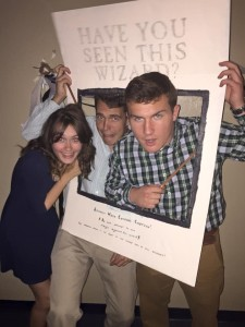 Bridget Chalifour, Mark DeSantis and Connor Hartzell enjoy the Yule Ball decorations.