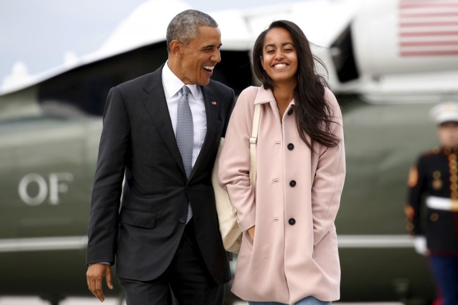U.S. President Barack Obama and his daughter Malia walk from Marine One to board Air Force One upon their departure from O'Hare Airport in Chicago